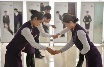Stewardesses for high-speed train take part in training program in Harbin