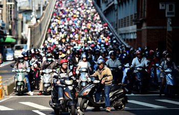 People ride motorcycles on bridge in southeast China's Taiwan