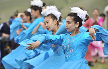 In pics: outdoor cultural performance given by Ulanmuqi in N China