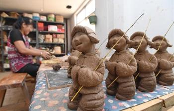 In pics: Sanchizhai clay sculpture N China