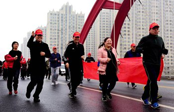 Fitness run held across China to greet upcoming New Year
