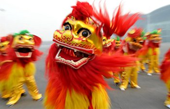 Folk artists practise lion dance to greet Chinese Spring Festival