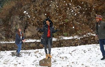 People enjoy first snowfall in Kathmandu, Nepal