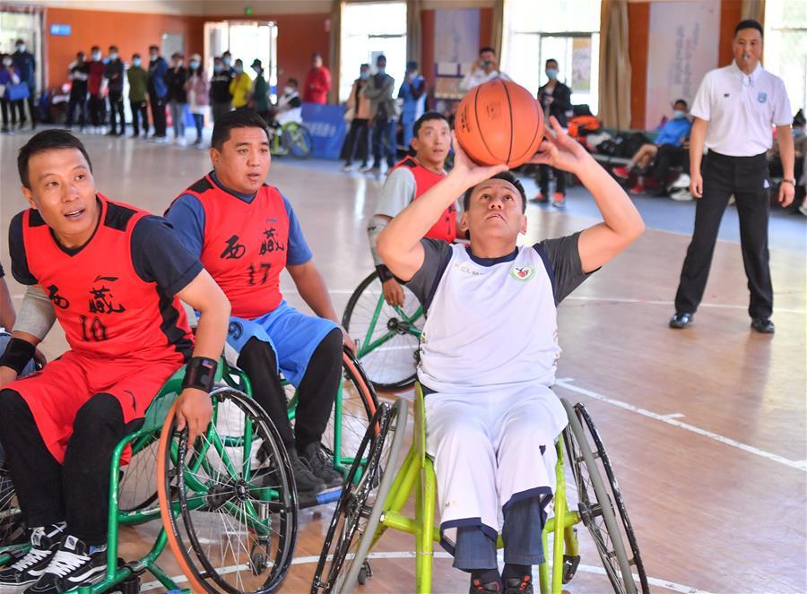 關愛殘疾人輪椅籃球隊公益活動在拉薩舉行(圖)
